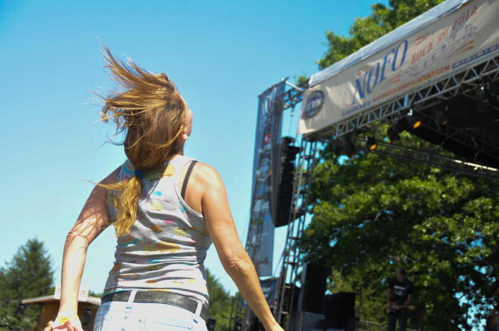 Sharon Gross, 53, of East Moriches dances while listening to one of the bands perform at the NOFO Rock and Folk Fest. (Photo by Frank Posillico)